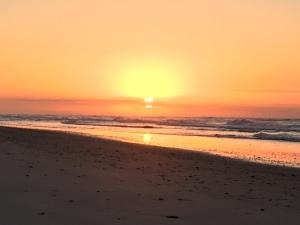 sunrise on a beach in NC